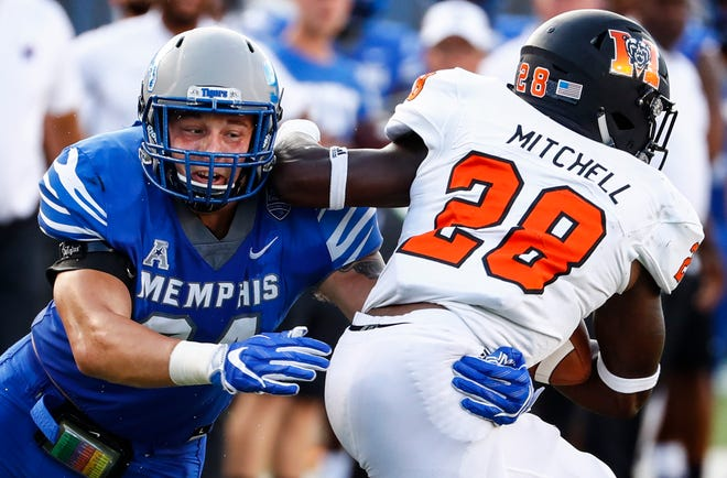 Memphis defender Jackson Dillon (left) brings down Mercer running back Tee Mitchell (right) during their college football game at The Liberty Bowl Memorial Stadium in Memphis, Tenn., Saturday, September 1, 2018.