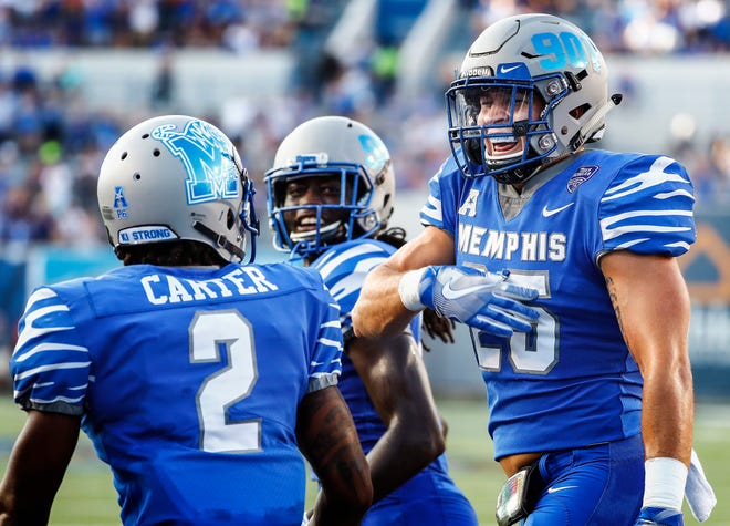 Memphis defender Austin Hall (right) celebrates a defensive touchdown against Mercer during their college football game at The Liberty Bowl Memorial Stadium in Memphis, Tenn., Saturday, September 1, 2018.