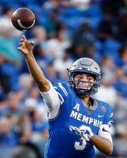Memphis quarterback Brady White makes a pass against the Mercer defense during their college football game at The Liberty Bowl Memorial Stadium in Memphis, Tenn., Saturday, September 1, 2018.