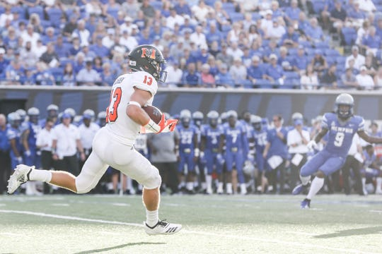 September 01 2018 - Mercer's David Durden, 13, runs with the ball during Saturday's game at the Liberty Bowl Memorial Stadium.