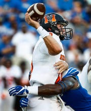Memphis defender Nehemiah Augustus (bottom) hits Mercer quarterback Robert Riddle (top) during their college football game at The Liberty Bowl Memorial Stadium in Memphis, Tenn., Saturday, September 1, 2018.