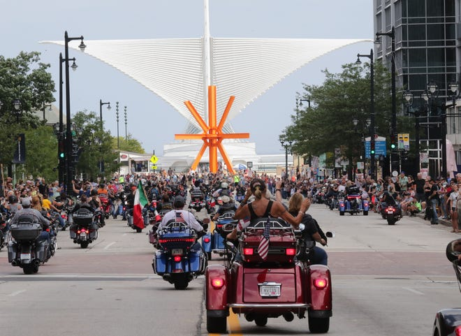Some of the thousands of Harley-Davidson motorcycle riders head east on Wisconsin Avenue toward the Milwaukee Art Museum. The Harley-Davidson 115th anniversary parade included thousands of motorcycles traveling through the streets of Milwaukee on Sunday.  The parade started at Miller Park and continued east on Wisconsin Avenue through downtown, ending at the lakefront.
