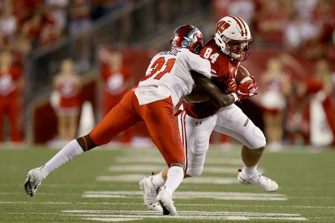 Redshirt freshman tight end Jake Ferguson (right) impressed Wisconsin coach Paul Chryst with his play Friday night against Western Kentucky.