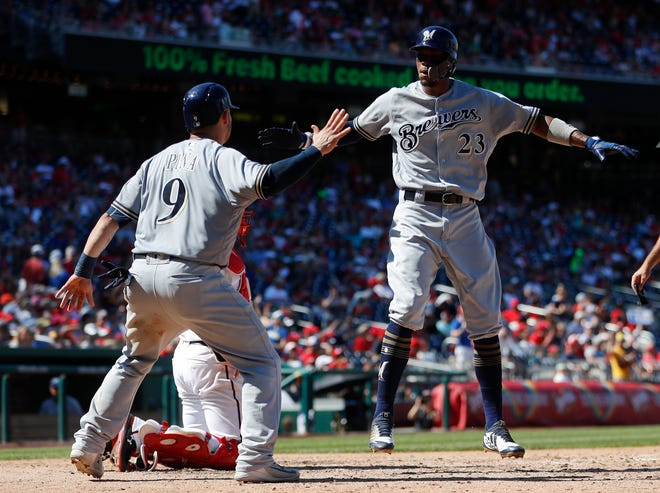 Milwaukee Brewers' Keon Broxton (23) celebrates with teammate Manny Pina after hitting a three-run home run off Washington Nationals pitcher Jefry Rodriguez during the fifth inning of a baseball game at Nationals Park, Sunday, Sept. 2, 2018, in Washington. (AP Photo/Pablo Martinez Monsivais) ORG XMIT: NAT113