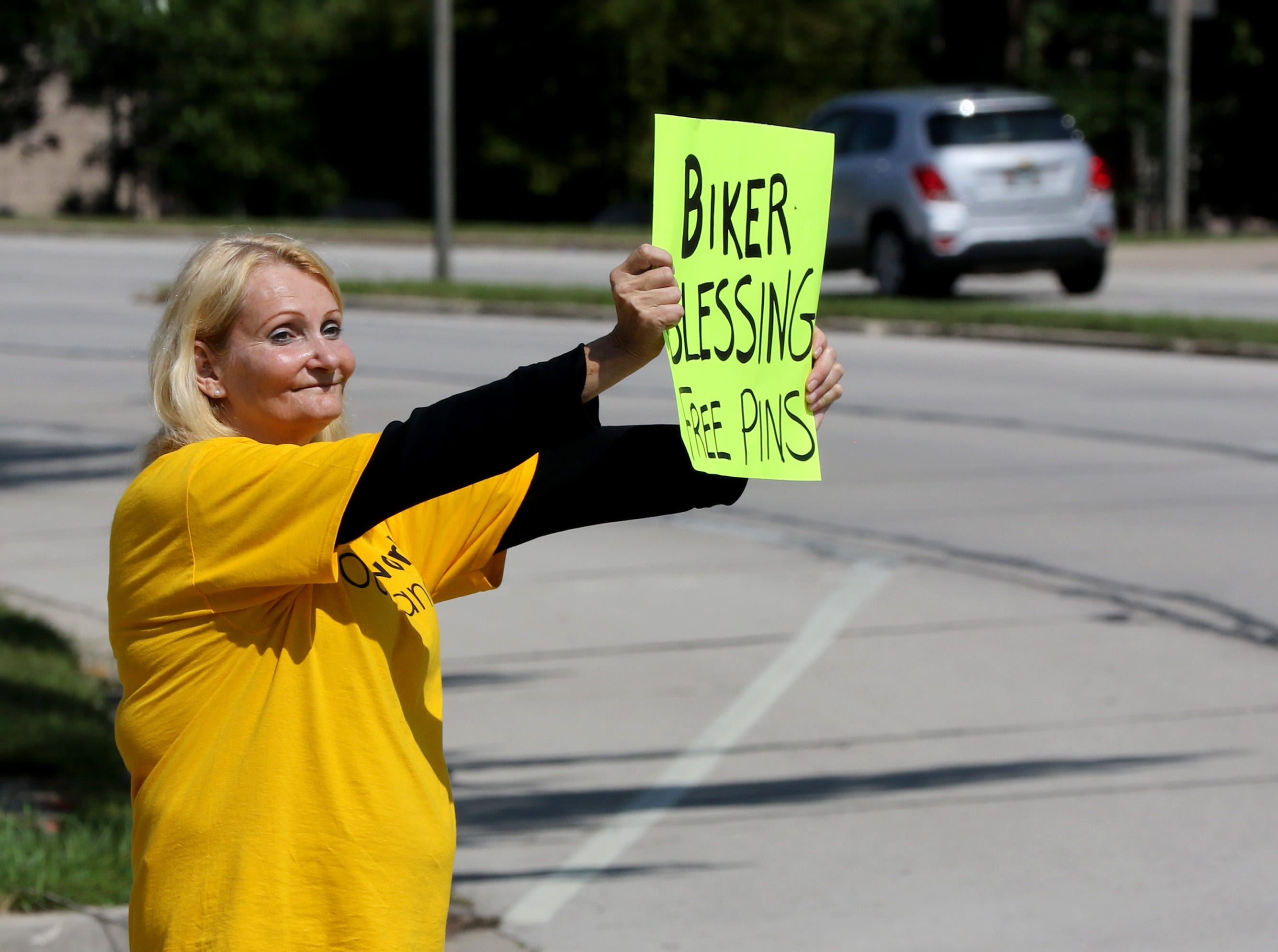 Betty Rispalje and other Redemption Lutheran Church members stood at the curb and at intersections to draw Harley drivers to a Biker Blessing on its property at 4057 N Mayfair Rd. in Wauwatosa on Aug 31.