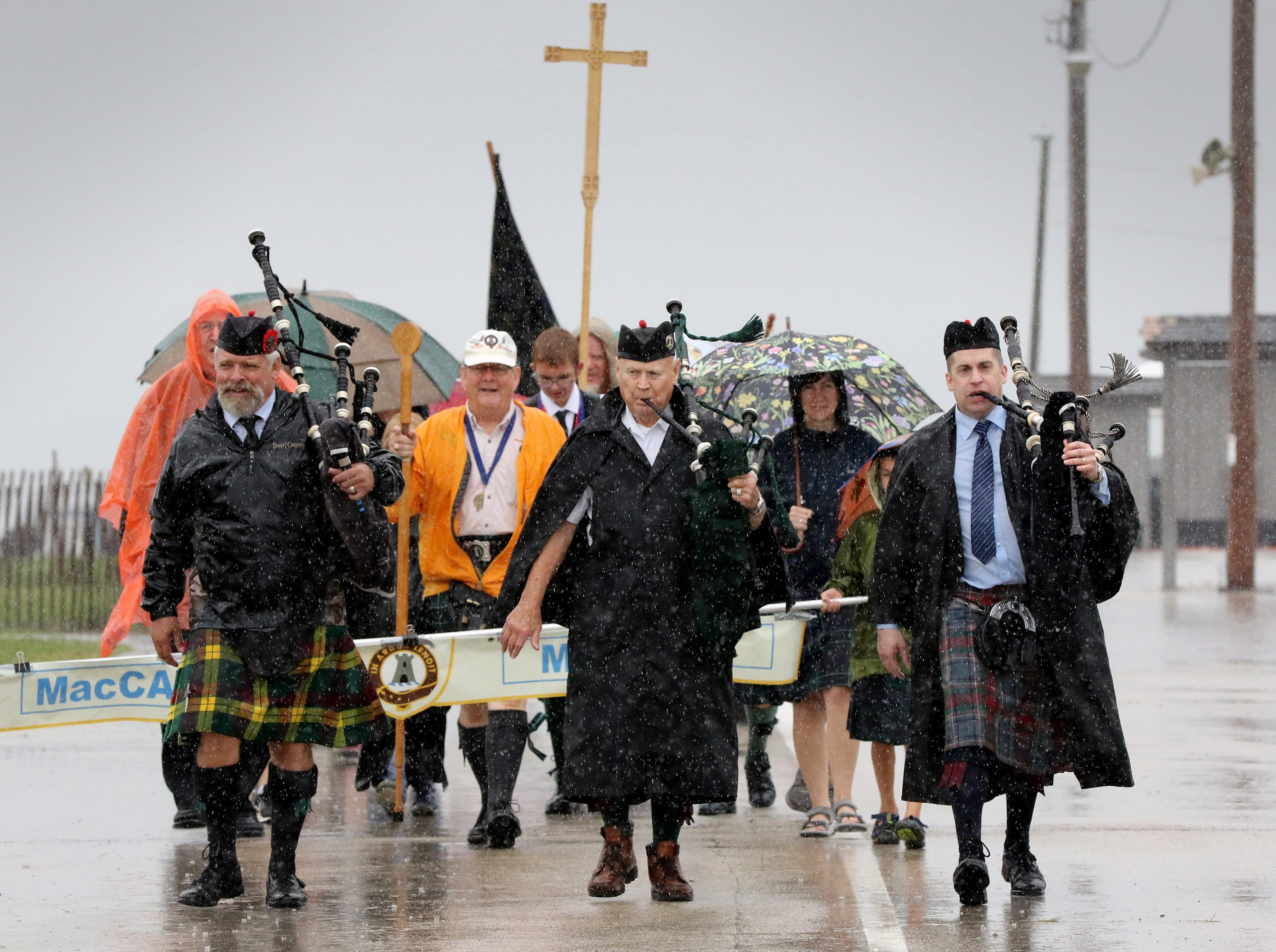 Pipers lead the Parade of the Tartans through the Waukesha County Fairgrounds through the rain during the Wisconsin Highland Games on Sept. 1