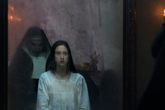 "Taissa Farmiga (right) plays a novitiate trying to learn the truth about a demonic nun's (Bonnie Aarons) role in some dark goings-on in ""The Nun."""