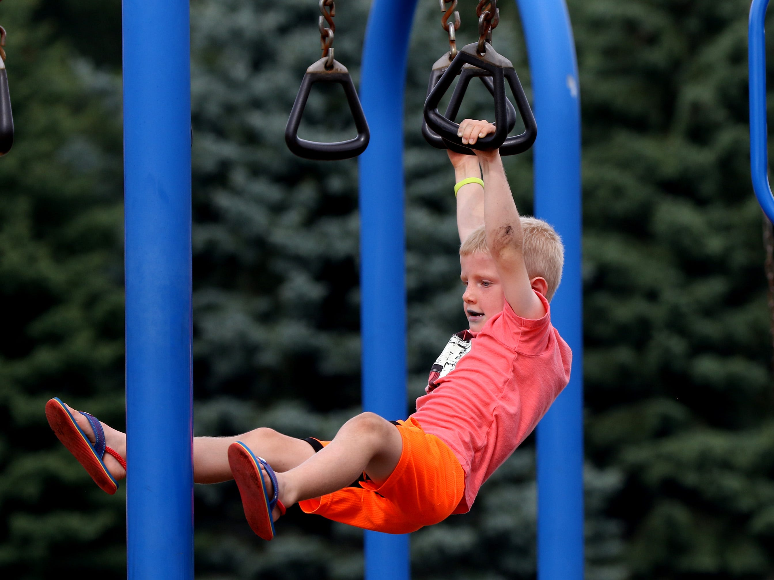 Ian Weber, 5, of Germantown finds the playground entertaining at Bonifest at St. Boniface Parish and School on Sept. 2.