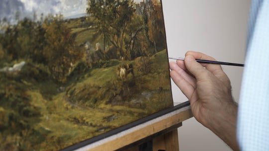 A conservator at the Milwaukee Art Museum works on a painting given to a predecessor institution in 1941. Is the work, as claimed at the time, by English landscape artist John Constable?