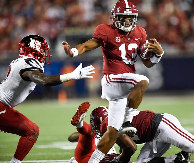 Alabama quarterback Tua Tagovailoa (13) carries against Louisville In first half action of the Camping World Kickoff at Camping World Stadium in Orlando, Fla., on Saturday September 1, 2018.