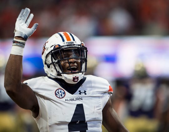 Auburn's Noah Igbinoghene (4) pumps up the crowd at Mercedes-Benz Stadium in Atlanta, Ga., on Saturday, Sept. 1, 2018. Auburn defeated Washington 21-16 in the Chick-fil-a Kickoff Game.