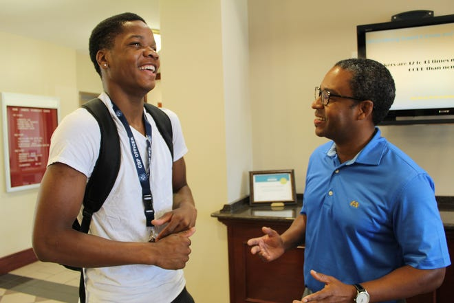 Marlon Sharp, left, and Johnny Moss III chat at Wallace Community College in Selma. Alvin Benn/Special to the Advertiser