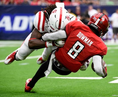Texas Tech kick returner De'Quan Bowman (8) is tackled by Mississippi defensive back Javien Hamilton during the first half of a college football game, Saturday, Sept. 1, 2018, in Houston. (AP Photo/Eric Christian Smith)