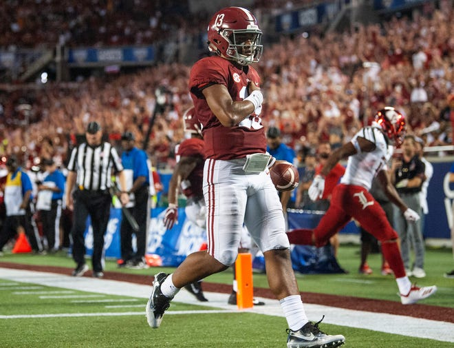 Alabama quarterback Tua Tagovailoa (13) scores a touchdown against Louisville In first half action of the Camping World Kickoff at Camping World Stadium in Orlando, Fla., on Saturday September 1, 2018.