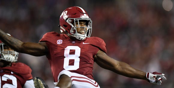 Alabama running back Josh Jacobs (8) celebrates a touchdown against Louisville In second half action of the Camping World Kickoff at Camping World Stadium in Orlando, Fla., on Saturday September 1, 2018.