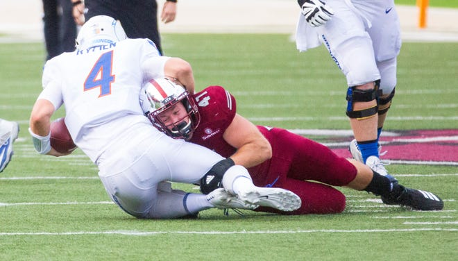Troy's Hunter Reese takes down Boise State's Brett Rypien during the first quarter.