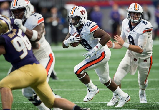 Auburn's JaTarvious Whitlow (28) runs the ball against Washington at Mercedes-Benz Stadium in Atlanta, Ga., on Saturday, Sept. 1, 2018. Auburn defeated Washington 21-16 in the Chick-fil-a Kickoff Game.