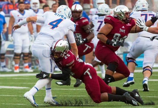 Troy's Justin Whisenhunt goes for a low tackle on Boise State's Brett Rypien.