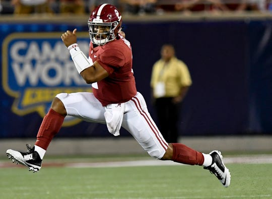 Alabama quarterback Jalen Hurts (2) carries against Louisville In second half action of the Camping World Kickoff at Camping World Stadium in Orlando, Fla., on Saturday September 1, 2018.