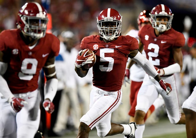 Alabama defensive back Shyheim Carter (5) intercepts a pass and returns it for a touchdown against Louisville In second half action of the Camping World Kickoff at Camping World Stadium in Orlando, Fla., on Saturday September 1, 2018.