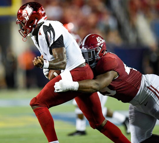 Alabama defensive lineman Isaiah Buggs (49) sacks Louisville quarterback Jawon Pass (4) in second half action of the Camping World Kickoff at Camping World Stadium in Orlando, Fla., on Saturday September 1, 2018.