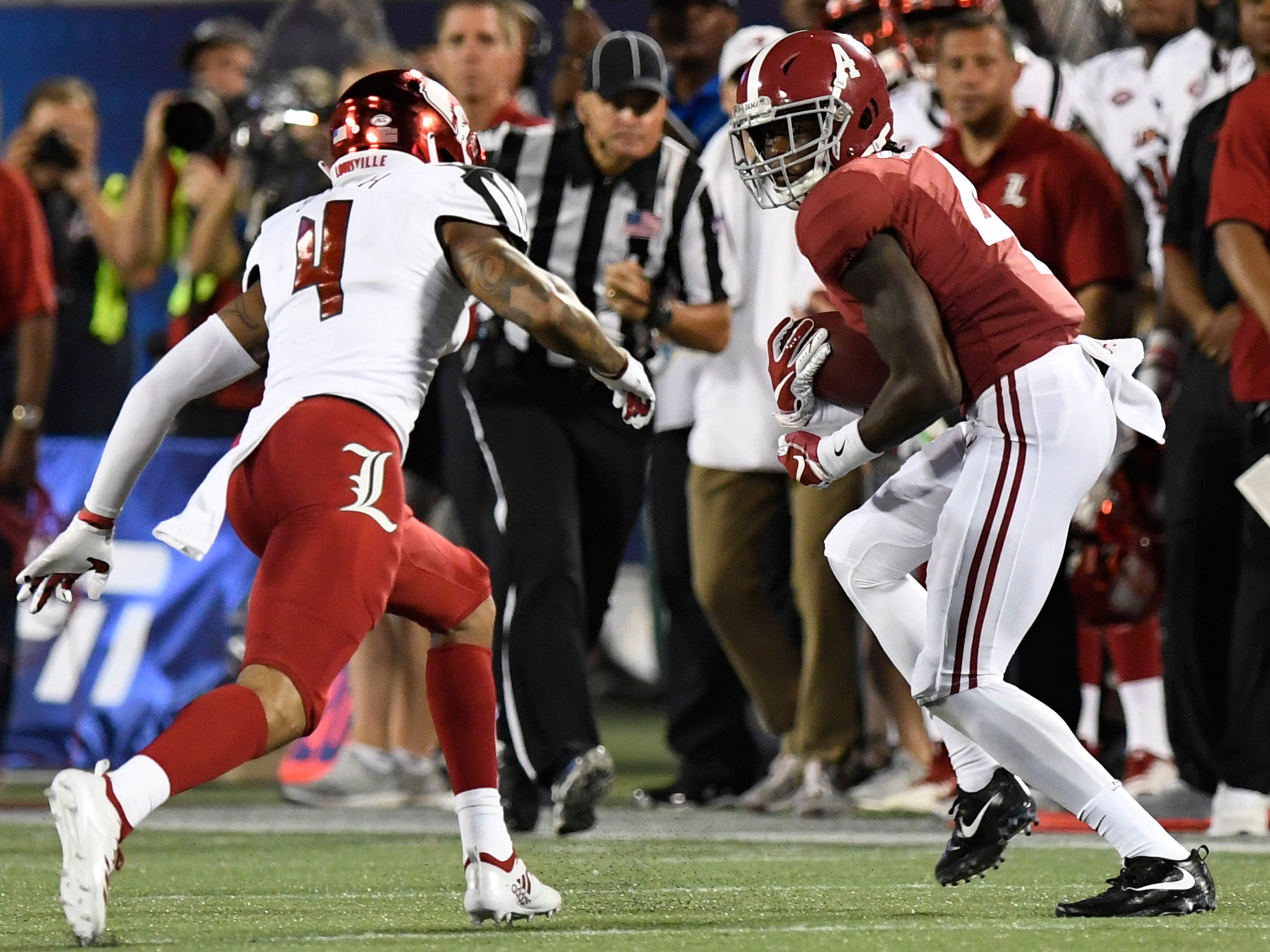 Alabama wide receiver Jerry Jeudy (4) catches a pass against Louisville safety TreSean Smith (4) In second half action of the Camping World Kickoff at Camping World Stadium in Orlando, Fla., on Saturday September 1, 2018.