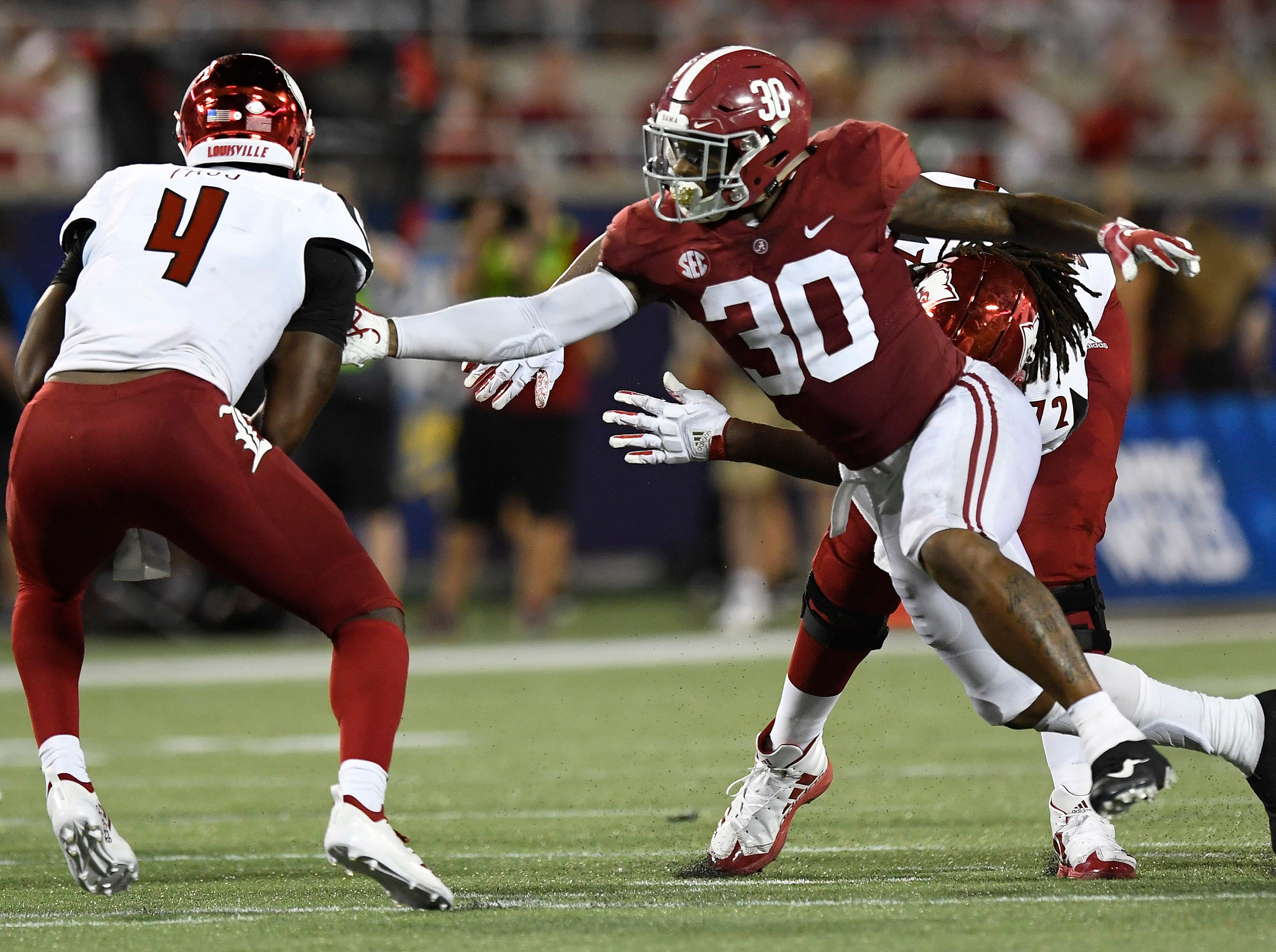 Alabama linebacker Mack Wilson (30) pressures Louisville quarterback Jawon Pass (4) In second half action of the Camping World Kickoff at Camping World Stadium in Orlando, Fla., on Saturday September 1, 2018.