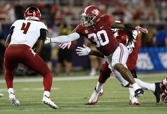 Alabama linebacker Mack Wilson (30) pressures Louisville quarterback Jawon Pass (4) In second half action of the Camping World Kickoff at Camping World Stadium in Orlando, Fla., on Saturday September 1, 2018.