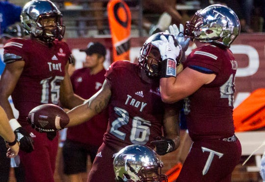 Troy's Zacc Weldon congratulates B.J. Smith after Smith scored earlier this year.
