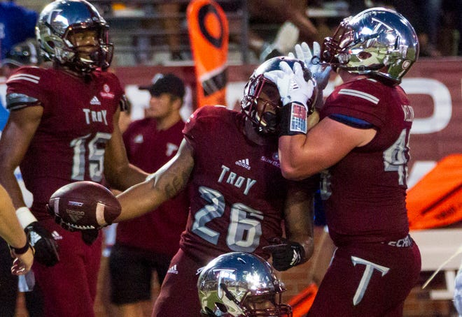 Troy's Zacc Weldon congratulates B.J. Smith after he runs the ball in for Troy's second touchdown of the game.