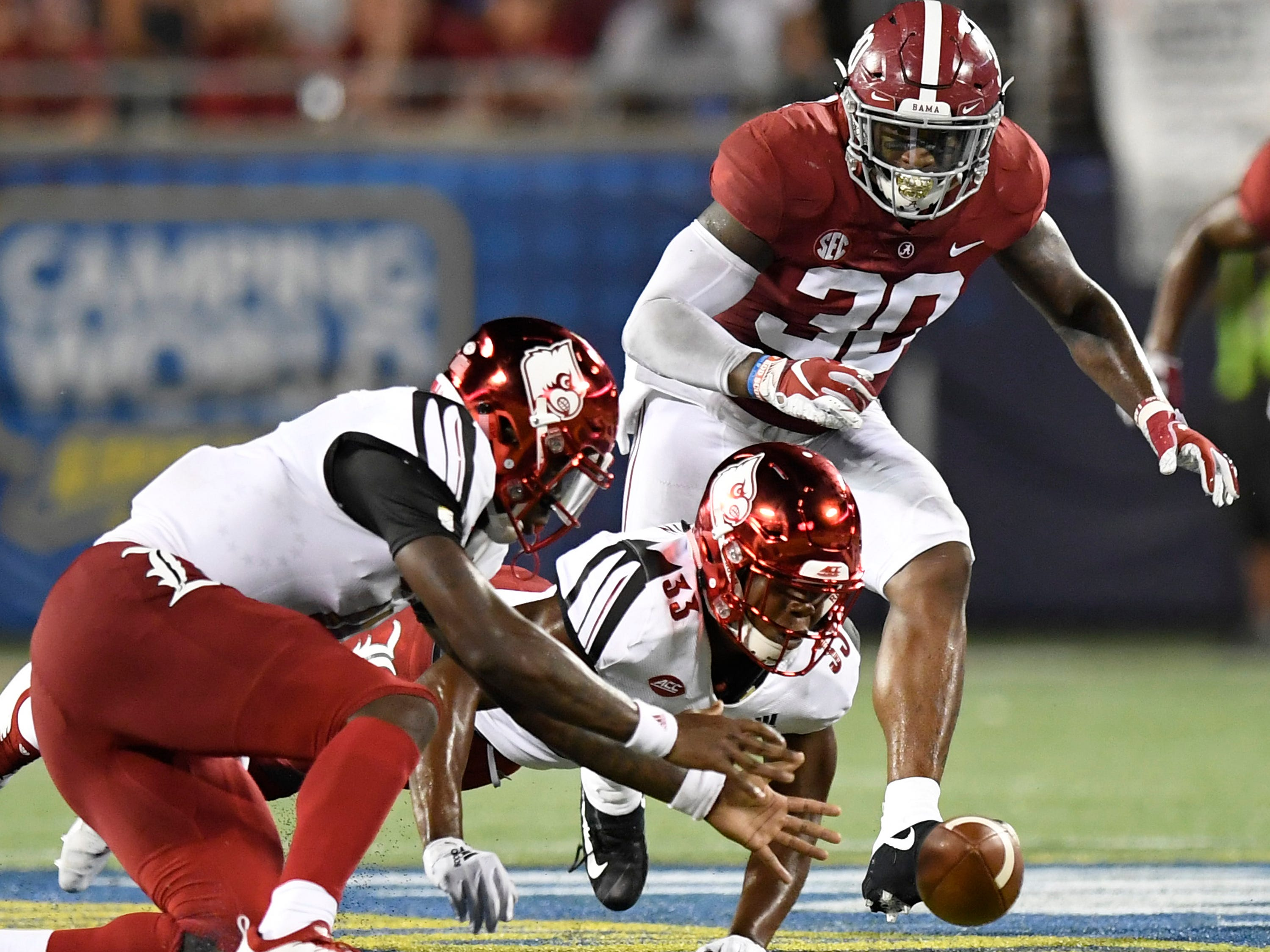 Alabama linebacker Mack Wilson (30) chases a fumbled ball by Louisville In first half action of the Camping World Kickoff at Camping World Stadium in Orlando, Fla., on Saturday September 1, 2018.