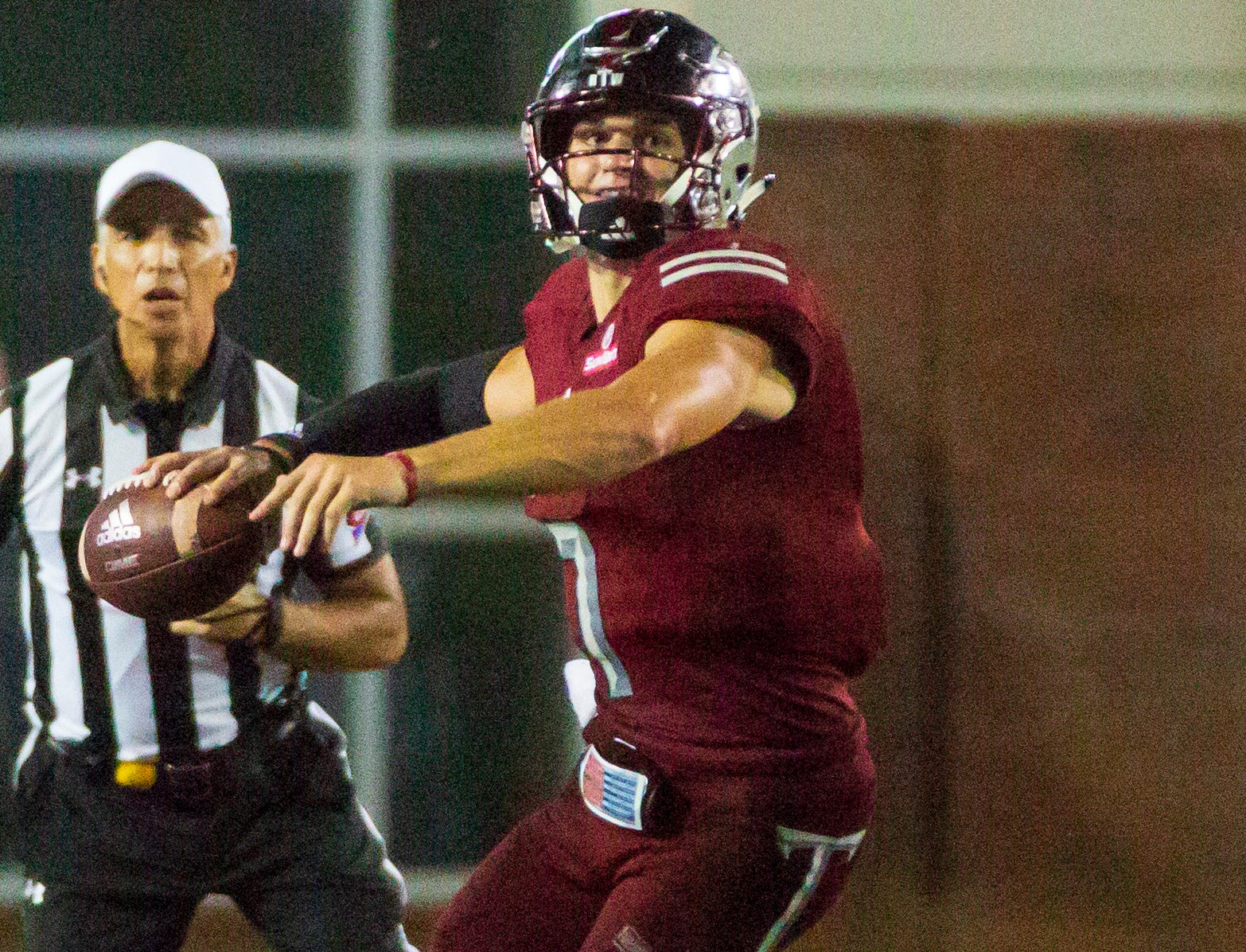 Troy's Kaleb Barker looks far as he prepares to throw down the field.