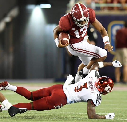 Alabama quarterback Tua Tagovailoa (13) is upended In first half action of the Camping World Kickoff at Camping World Stadium in Orlando, Fla., on Saturday September 1, 2018.
