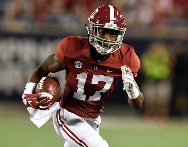 Alabama wide receiver Jaylen Waddle (17) carries against Louisville In first half action of the Camping World Kickoff at Camping World Stadium in Orlando, Fla., on Saturday September 1, 2018.