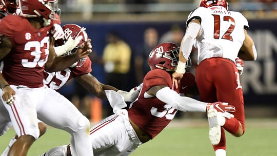 Alabama linebacker Mack Wilson (30) stops Louisville running back Trey Smith (12) In first half action of the Camping World Kickoff at Camping World Stadium in Orlando, Fla., on Saturday September 1, 2018.