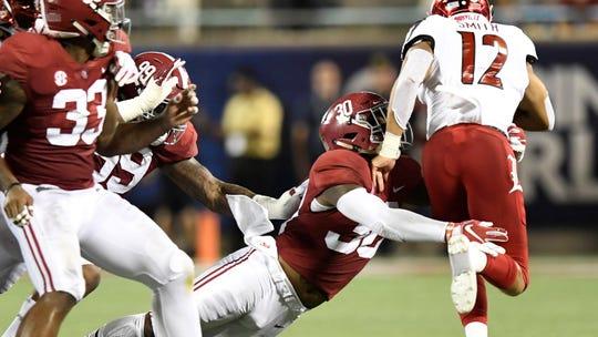 Alabama linebacker Mack Wilson (30) stops Louisville running back Trey Smith (12) In first half action of the Camping World Kickoff at Camping World Stadium in Orlando, Fla., on Saturday September 1, 2018.