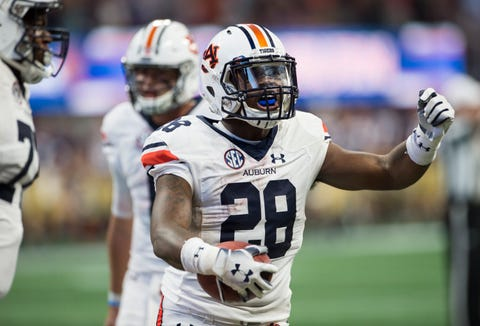 Auburn's JaTarvious Whitlow (28) celebrates after scoring a rushing touchdown against Washington at Mercedes-Benz Stadium in Atlanta, Ga., on Saturday, Sept. 1, 2018. Auburn defeated Washington 21-16 in the Chick-fil-a Kickoff Game.