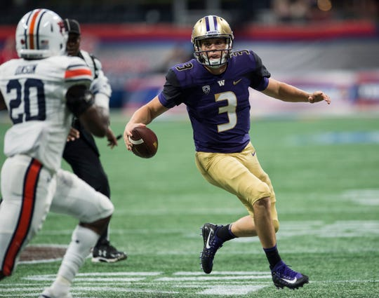 Washington's Jake Browning (3) looks to run the ball against  Auburn at Mercedes-Benz Stadium in Atlanta, Ga., on Saturday, Sept. 1, 2018. Auburn defeated Washington 21-16 in the Chick-fil-a Kickoff Game.