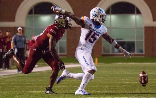 Boise State's Jalen Walker celebrates after he swatted the ball away from Troy's Terence Dunlap.