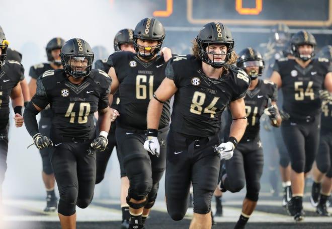 Vanderbilt players head onto the field before the game against MTSU at Vanderbilt Stadium Saturday, Sept. 1, 2018, in Nashville, Tenn.