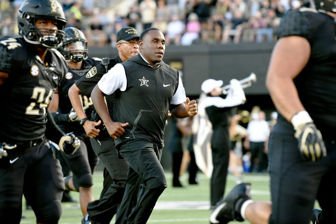 Vanderbilt head coach Derek Mason and the team take the field before the game against MTSU at Vanderbilt Stadium Saturday, Sept. 1, 2018, in Nashville, Tenn.