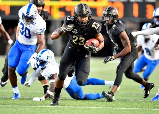 Vanderbilt running back Khari Blasingame (23) heads into the end zone with the team's first touchdown of the game against MTSU at Vanderbilt Stadium Saturday, Sept. 1, 2018, in Nashville, Tenn.