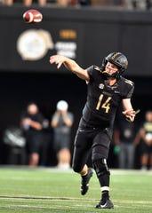 Vanderbilt quarterback Kyle Shurmur (14) passes in the first half against MTSU at Vanderbilt Stadium Saturday, Sept. 1, 2018, in Nashville, Tenn.