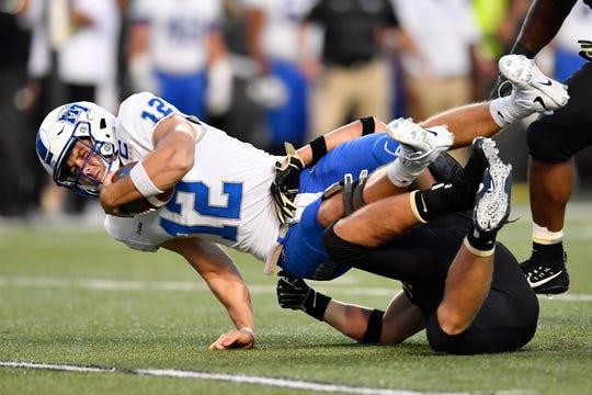 Vanderbilt linebacker Colin Anderson (18) sacks Middle Tennessee quarterback Brent Stockstill (12) in the first half at Vanderbilt Stadium Saturday, Sept. 1, 2018, in Nashville, Tenn.