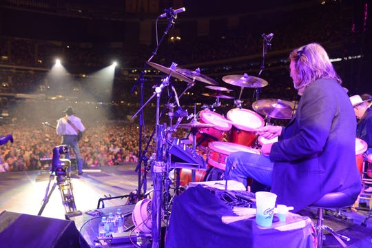 Mike Kennedy on stage with George Strait