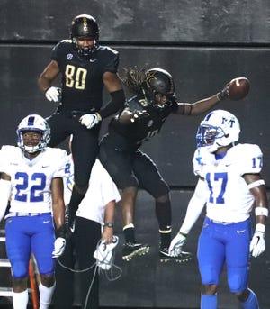 Vanderbilt wide receiver Chris Pierce (19) celebrates his third-quarter touchdown with tight end Jared Pinkney (80) against MTSU at Vanderbilt Stadium Saturday, Sept. 1, 2018, in Nashville, Tenn.