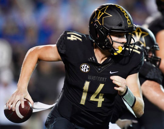 Vanderbilt quarterback Kyle Shurmur (14) scrambles out of the pocket in the second quarter against MTSU at Vanderbilt Stadium Saturday, Sept. 1, 2018, in Nashville, Tenn.
