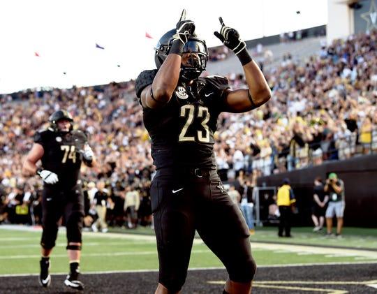 Vanderbilt running back Khari Blasingame (23) celebrates his touchdown in the first quarter against MTSU on Sept. 1.