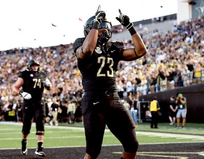 Vanderbilt running back Khari Blasingame (23) celebrates his touchdown in the first quarter against MTSU at Vanderbilt Stadium Saturday, Sept. 1, 2018, in Nashville, Tenn.