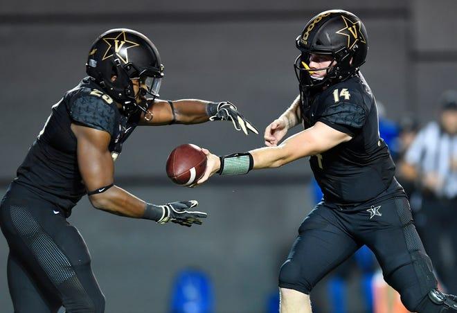 Vanderbilt quarterback Kyle Shurmur (14) hands off to running back Khari Blasingame (23) in the first half against MTSU at Vanderbilt Stadium Saturday, Sept. 1, 2018, in Nashville, Tenn.